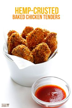 Hemp Crusted Chicken Tenders --Have you tried cooking with hemp seeds yet? They are healthy, super high in protein and other good stuff, and they taste kind of like pine nuts. And they make the perfect gluten-free breading for these tasty baked chicken tenders!   gimmesomeoven.com #glutenfree