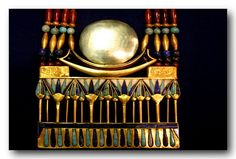 This piece must be a replica. The disk and crescent on the original are of a different metal than the boat and there is a small flaw on the 4th drop from the right. See #269k for reference. Description said: tutankhamun treasure Cairo museum