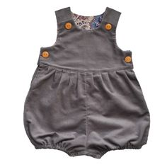 db1193dd0b7c Our unisex romper suit is made from a luxurious medium-weight grey corduroy  and lined