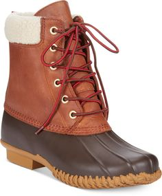 Tommy Hilfiger Women's Russel Duck Faux-Fur Booties. This durable leather and rubber style is ready for action. The Russel Duck faux-fur booties by Tommy Hilfiger.