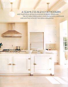 white kitchen with fridge handles
