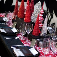 Top 100 Christmas Table Decorations - Christmas Decorating -so many different tablescapes to choose from. Love the black and red with this one.