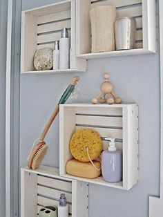 Hang painted wooden crates on bathroom walls for display and storage