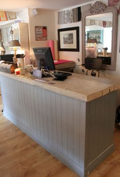#Charming #Shop #Counter - If you're running a boutique then you know the importance of little details. This counter, for example, has rustic charm to match what the boutique sells. Details like the distressed counter and antique mirror draw customers back for repeat visits.