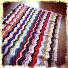 Colorfull blanket in ripple pattern.
