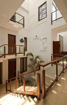 sajeev kumar s residence at girugambakkam, near m.t hospital, chennai ,tamilnadu modern corridor, hallway & stairs by muraliarchitects modern Stair Railing Design, Home Stairs Design, Duplex House Design, Interior Stairs, Home Room Design, Modern House Design, Home Interior Design, Railings, Casa Patio