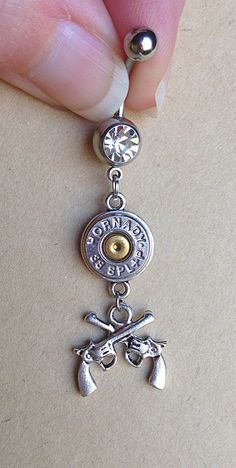 Bullet jewelry. Belly button ring with guns by CaliberGirlJewelry