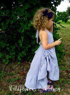 Little Nora Jane Twirl Dress Tutorial -- basically a circle skirt that is offset to make a fishtail in back