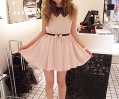 such a cute pale pink dress with a black belt and collar