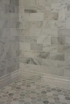 """Love the large tile & base""""tile"""" border. Maybe add some color with a vertical stripe of some mosaic type tile."""