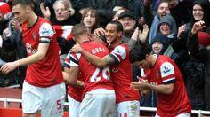 Arsenal celebrate against Norwich