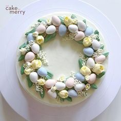 Easter Egg Wreath Cake How to create a beautiful wreath cake for Easter using buttercream flowers and mini chocolate eggs. Cake Decorating Frosting, Cake Decorating Videos, Cake Decorating Techniques, Cookie Decorating, Decorating Ideas, Pretty Cakes, Cute Cakes, Buttercream Flower Cake, Buttercream Cake Designs
