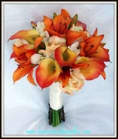 I'm thinking of an orange and white theme... maybe a bouquet of orange calalilies and white freesias? Peach, orange, and flame/orange, wedding bouquet