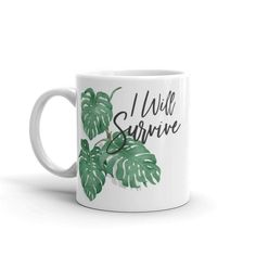 Items similar to Plant Mug / I Will Survive Coffee Mug / Gift for Houseplant Lovers / Gardening Gift / Printing on Etsy Painted Coffee Mugs, Beautiful Lettering, Cute Mugs, Garden Gifts, Leaf Design, Cute Gifts, House Plants, White Ceramics, Survival
