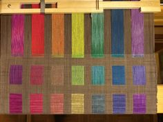 I am very attracted to good uses of structure and thus doubleweave looked  like a fine direction to explore. As a first venture in doubleweave, I  undertook this project to make rainbow windowed wall hangings. My  sister-in-law is a therapist with a diverse set of clients and I offered to  make a rainbow welcome piece for her offices. Since weaving is more  satisfying than warping, I decided to make enough warp for three wall  hangings--one for my office and one to add color to our…