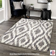 An oversized ogee motif is revitalized with modern dimension by space dyed striations in the neutral design of Orian Rugs Costra Cream Area Rug. Shades of natural beige and taupe make coordination with existing furnishings easy.