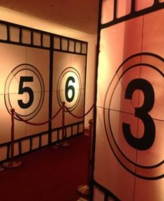 Hollywood Glamour Themed Party Event - you could do this on a smaller scale with posterboard.  Great for a walkway into a backyard movie party.