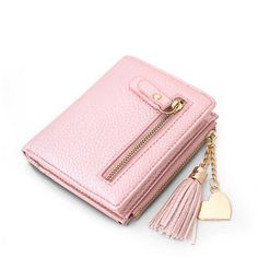 Just In Bessie Heart Frin... Shop Now! http://www.shopelettra.com/products/bessie-heart-fringe-wallet?utm_campaign=social_autopilot&utm_source=pin&utm_medium=pin