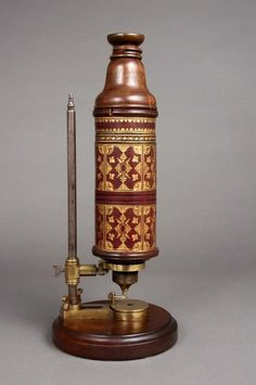 "wasbella102:  ""This microscope, made by Christopher Cock in London in 1665, was used by Robert Hooke of the Royal Society. Hooke is the author of ""Micrographia"" and was the first person to apply the word ""cell"" to microscopic structures."""