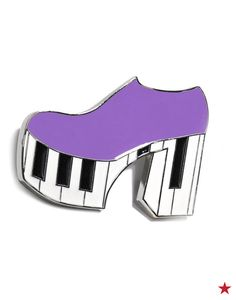 Only Gaga could bring us a pin like this! This awesome piano shoe accessory is a part of her new Love Bravery Collection with music legend Sir Elton John.