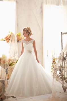 Style #2607 Chantilly Lace on Tulle with Wide Hemline and Satin Waistband by @Mori Lee by Madeline Gardner