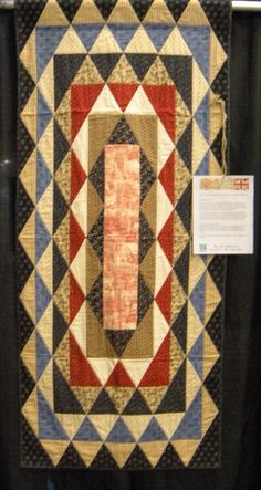 Reproduction War of 1812 Soldier's Cot Quilt, something I could see my mama making.