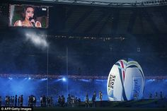 She's a screen star! Laura Wright is seen on a giant screen during the opening ceremony of the 2015 Rugby World Cup at Twickenham stadium