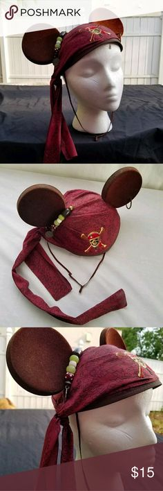 Disney Mouse Ears Jack Sparrow pirate hat Available is a Disney Pirates of the Caribbean Mickey Mouse ears hat. It has a bandanna on it, an earring and a little dangly bead decoration like on Jack Sparrow's (CAPTAIN. CAPTAIN Jack Sparrow's) own headwear. There is a small part of one ear where the velvet is rubbing off (see photos) and the elastic band no longer stretches. You could cut it off and replace it, or simply cut it in two and tie it if you wish. I'll leave it up to the new owner to…
