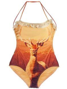 Maillot de bain une pièce orange  We Are Handsome à dos nus avec bretelle autour du cou et imprimé coucher de soleil sur toute la surface.