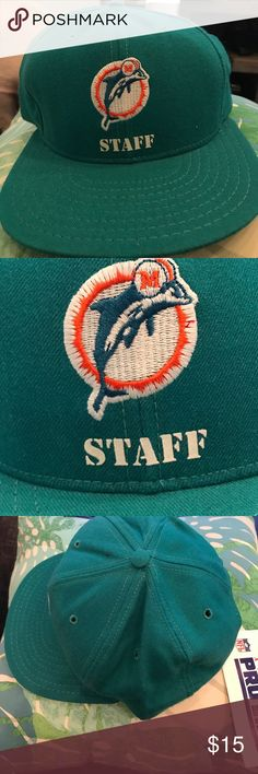 """Vintage Pro-line NFL MIAMI DOLPHINS """"STAFF"""" green Vintage Pro-line NFL MIAMI DOLPHINS """"STAFF"""" green & white SnapBack hat,Never worn, with tags. pictures provided of condition. Please keep in mind this item is vintage. May contain dust. All bundles of 2 or more receive 20% off. Closet full of new, used and vintage Vans, Skate and surf companies, jewelry, phone cases, shoes and more Accessories Hats"""