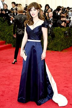 Zooey Deschanel in a navy satin Tommy Hilfiger gown with a ruched neckline at the 2014 Met Gala