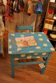 A whimisal touch for a child's table....I'm sure a ittle one would spends hours here coloring, working puzzles, creating..