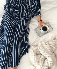Cuddling up on a down comforter with a cuddly blanket and warm drink in a fabulous robe! No stress allowed here!