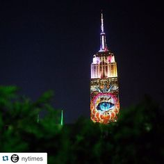 """From the New York Times: In an attempt to draw attention to the plight of endangered species, the artists Louie Psihoyos and Travis Threlkel projected digital images of the creatures onto the @empirestatebldg on Saturday night. Although the two were calling the event as a """"weapon of mass instruction,"""" Travis told @nytimes for an article published last week: """"We're going to try to create something beautiful. Not bum people out."""" @hlswift captured this view — accented by some junglish…"""