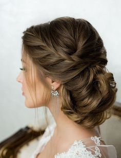 chic side french braided low twisted updo wedding hairstyle