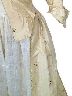 Robe a L' Anglaise c. 1780 From the Brooklyn Museum of Art, New York  Rose and green striped cream taffeta.  Self fabric covered buttons for decoration.  Ruched self fabric bands and ruched bands with spiral corded centers. Original leather patches sewn on to each underarm to protect the robe's fabric.