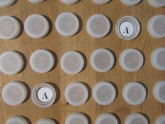 Recycled Memory Game. I haven't been collecting bottle caps but I do have a collection of beer caps. Can easily spray paint them all to match.