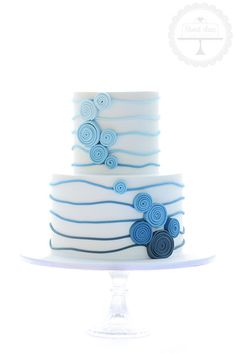 A sweet and simple wedding cake in ombre blue to complement the couple's theming