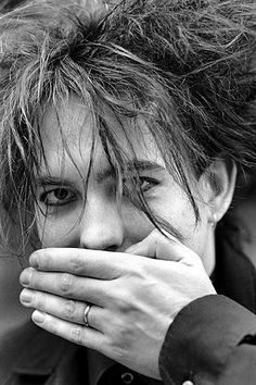 Robert Smith - The Cure // promise ring  (I remember this!  He was promised many many many years before he actually got married.  The only musician I've EVER seen show that kind of commitment).