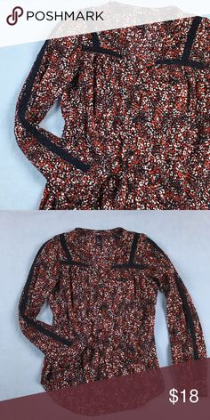 "GAP Red And Navy Floral Lace Inset Cotton Shirt GAP floral button down shirt with red, white, and navy blue print.  Lace trim insets are navy blue.  Rounded hem, loose fit.  100% cotton.  In excellent used condition - no flaws.  Flat lay measurements: length 26"", width across underarms 17"", sleeve 24"". GAP Tops Button Down Shirts"