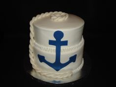 "Welcome home cake for a young man who is in the Navy and has been gone for 2 years. 9"" red, white and blue cake and 8"" red velvet.  Covered in buttercream with a fondant rope and anchor. From CakeCentral website."