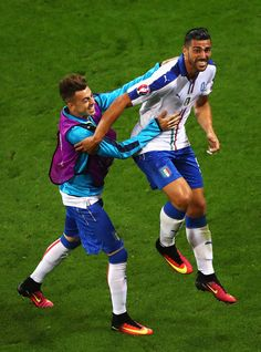 Graziano Pelle (R) of Italy celebrates scoring his team's second goal with his team mate Stephan El Shaarawy (L) during the UEFA EURO 2016 Group E match between Belgium and Italy at Stade des Lumieres on June 13, 2016 in Lyon, France.
