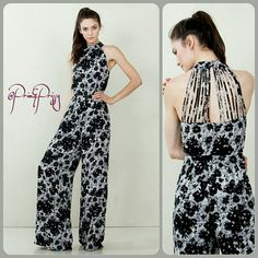 Prim Jumpsuit Abstract floral jumpsuit with a halter neckline. Multi strap detail in the back. Zipper closure on back.  Available in XS, S, M, L. @Prim&Prissy Pants Jumpsuits & Rompers