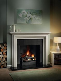 The Gallery Modena Limestone Fireplace with optional Matrix Fire Basket consists of the Modena Agean limestone mantel, slip set, x hearth, x inner hearth, reeded fireboard chamber and optional Matrix cast iron fire basket. Fireplace Mantel Surrounds, Fireplace Grate, Limestone Fireplace, Home Fireplace, Fireplace Design, Fireplaces, Fireplace Ideas, Farmhouse Fireplace, Fireplace Inserts