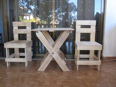 2 pallet chairs and a folding table for my terrace.…