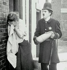 "Chaplin with Janet Sully in ""Easy Street""."