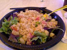 Quinoa salad with tomatoes, grapes,  kale, arugula, & a vinaigrette dressing