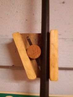 Wooden broom holder. You could use this for pipe clamps and any long handled tool