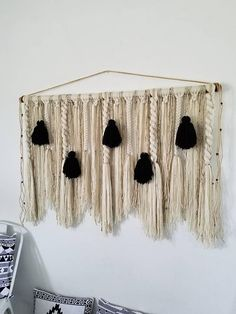 This is a MADE TO ORDER hanging! I will have it completed within 2 weeks of purchase. This hanging is full of twists, braids, macramé and tassels. Each section is a combination of many yarn strands. It would work great above a bed, sofa or on any large wall space to add a cozy,