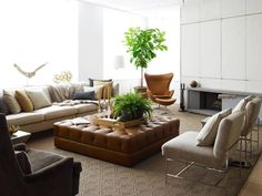 Mr Call design, eclectic living room, brown leather tufted ottoman, Egg chair